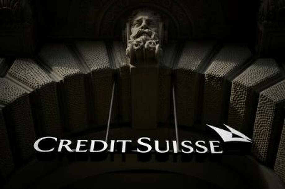 The sign of Swiss banking giant Credit Suisse is seen on November 2, 2013 in Zurich.  AFP PHOTO / FABRICE COFFRINI        (Photo credit should read FABRICE COFFRINI/AFP/Getty Images) Photo: AFP/Getty Images / 2013 AFP