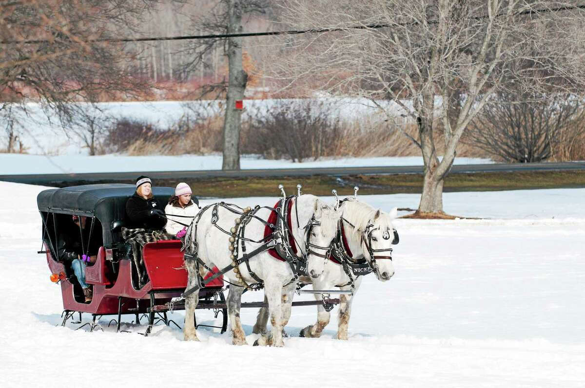 Contributed photos Horse-drawn carriage rides are just one of the many attractions that will be found at the Lyman Orchards winter festival Feb. 20-22.