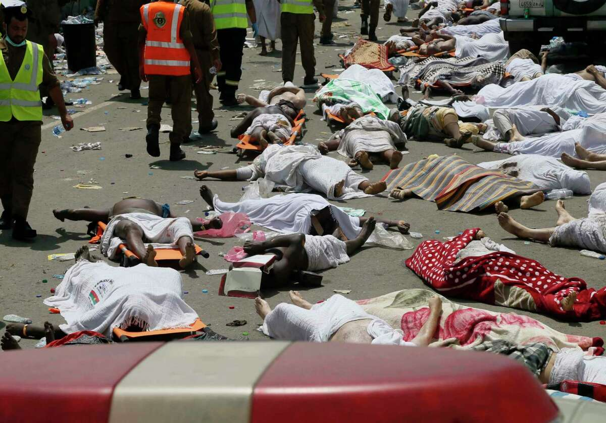 In this Thursday, Sept. 24, 2015 file photo, bodies of people who died in a crush in Mina, Saudi Arabia during the annual hajj pilgrimage lie in a street. Hundreds were killed and injured, Saudi authorities said. The crush happened in Mina, a large valley about five kilometers (three miles) from the holy city of Mecca that has been the site of hajj stampedes in years past. A new tally shows last month's crush and stampede at the Saudi hajj was the deadliest event to ever strike the annual pilgrimage. The Associated Press count Friday, Oct. 9, 2015, shows at least 1,453 people died Sept. 24 in Mina. Saudi officials have said their official figure of 769 killed and 934 injured in the disaster remains accurate.