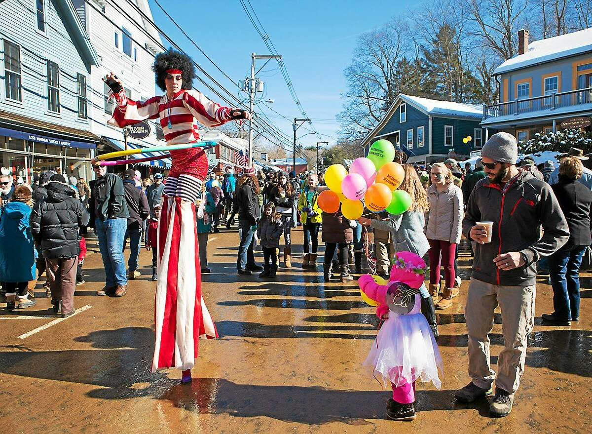 Photos by John Stack Merrymakers enjoy a stilt walker at last year's Chester Winter Carnivale, which returns to town Sunday, Feb. 15 with entertainment, food and fun for all ages.