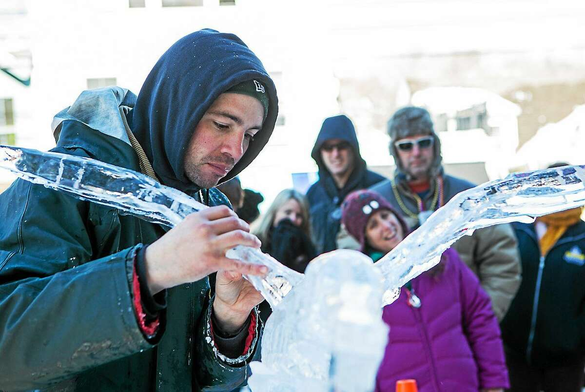 Photo by John Stack Richard Daly works on his ice sculpture during the 2014 Winter Carnivale. Daly holds the Guinness Book of World Records for the fastest time to create ice sculptures.