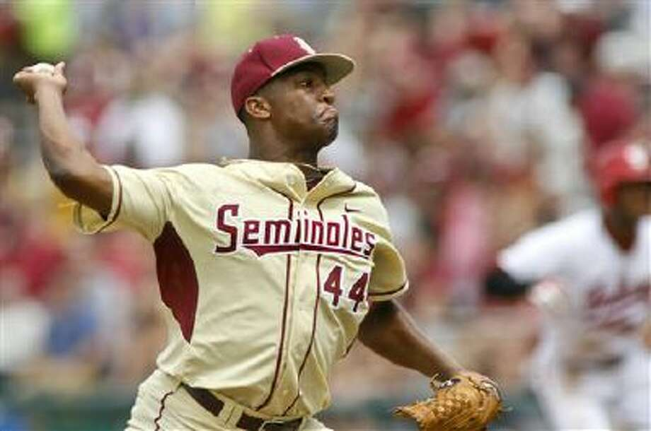 Florida State pitcher Jameis Winston (44) throws in the seventh inning of an NCAA college baseball tournament super regional game against Indiana on Sunday, June 9, 2013, in Tallahassee, Fla. Indiana won 11-6, and advances to the College World Series. (AP Photo/Phil Sears) Photo: AP / FR170567 AP