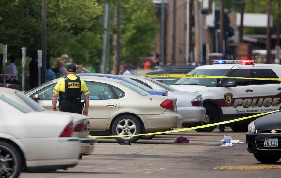 Authorities investigate a shooting at Texas Southern University, Friday, Oct. 9, 2015, in Houston. A student was killed and another person was wounded in a shooting outside a student-housing complex on Friday, and police have detained at least two people, authorities said. Photo: (Cody Duty/Houston Chronicle Via AP)   / Houston Chronicle