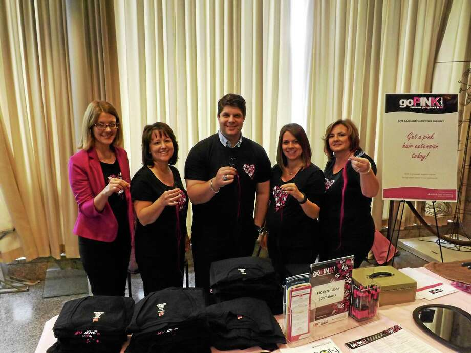 Middletown Mayor Dan Drew shows off the pink hair extension clip he received Thursday as part of the Middlesex Hospital goPINK Project. From left are: Sarah Moore and Kathleen Russo of Middlesex Hospital, Mayor Dan Drew, Jessica Fanska of Hair Solutions and Ellie Gagnon of EG Salon. Photo: Robert Mayer — The Middletown Press