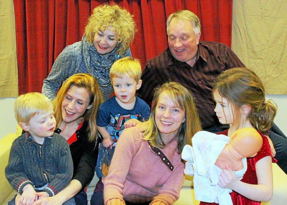 "Photo by Anne Hudson Top, from left, are Beverley Taylor and Michael Cartwright; bottom, from left, areAtticus Nischan, Jeanie Rapp, Kase Vradenburgh, Vanessa Vradenburgh, Elle Vradenburgh. The group makes up the cast of ""Motherhood Out Loud"" a staged reading at the Connecticut Cabaret Theater Feb. 20-22. Photo: Journal Register Co."