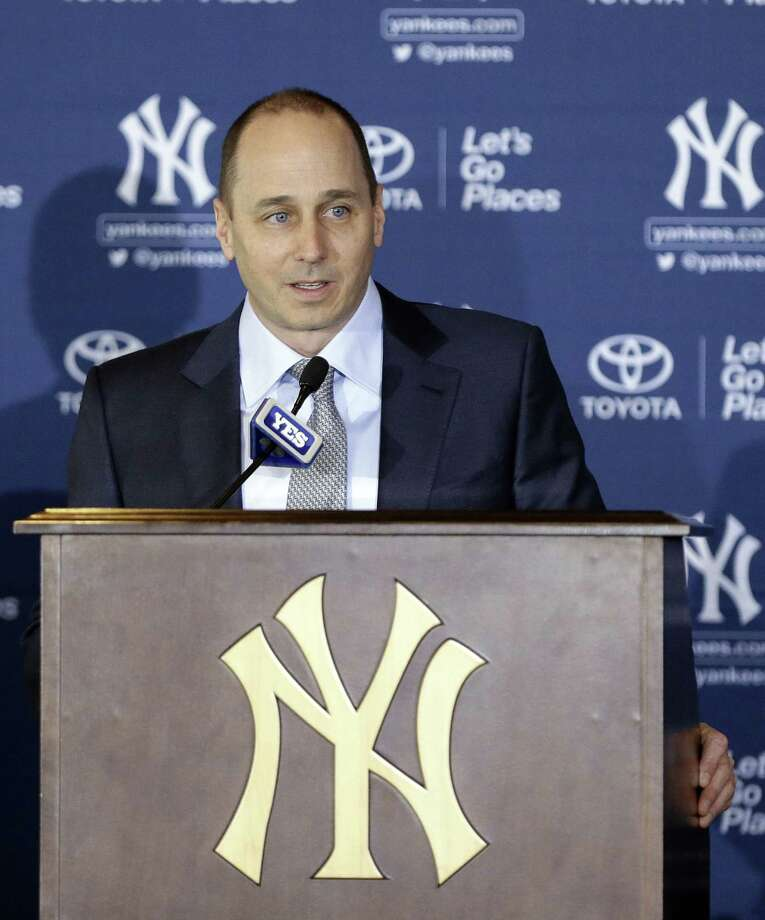 The New York Yankees announced Friday they have re-signed general manager Brian Cashman to a three-year contract. Photo: Frank Franklin II — The Associated Press File Photo  / AP