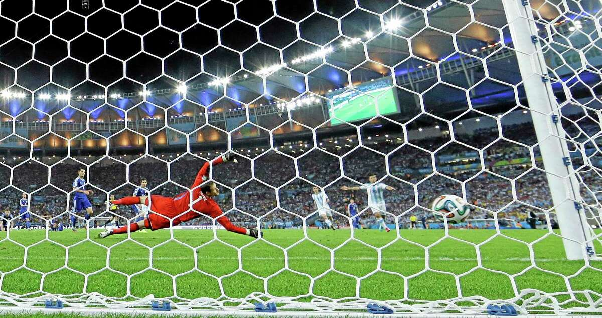 Bosnia's goalkeeper Asmir Begovic looks to the ball as Argentina's Lionel Messi scores his side's second goal on Sunday.