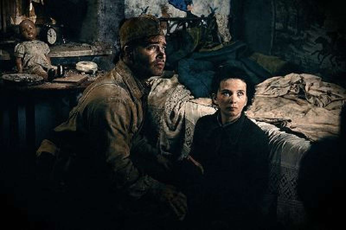 This image released by Sony Pictures shows Philippe Reinhardt, left, and Mariya Smolnikova in a scene from