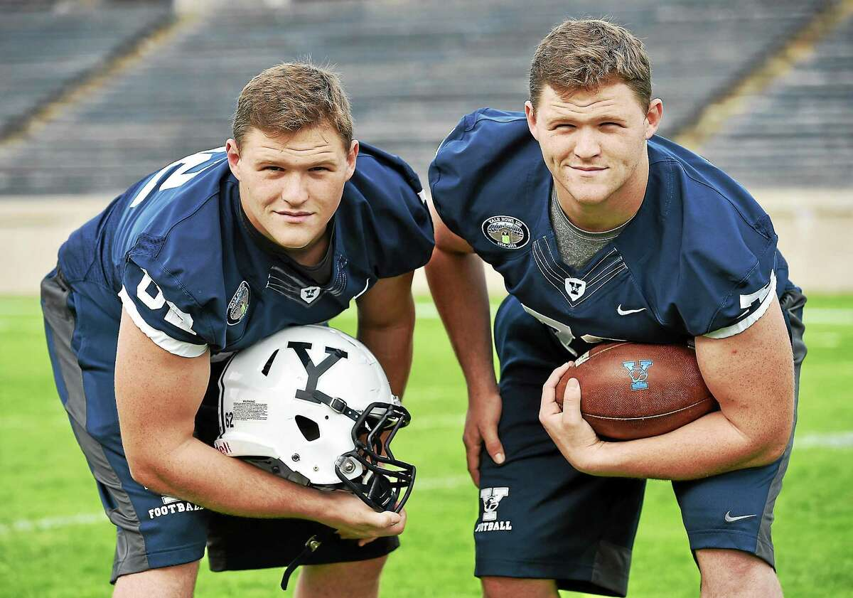 Twins Derrek, left, and Dustin Ross are both backup offensive linemen for Yale.