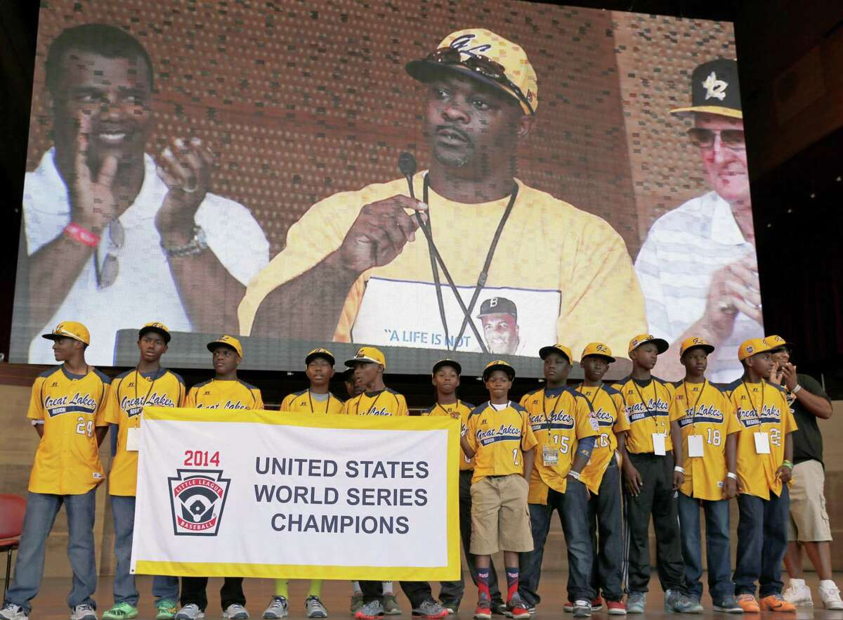 In this Aug. 27, 2014 file photo, members of the Jackie Robinson West All-Stars Little League team participate in a rally celebrating their U.S. championship in Chicago.