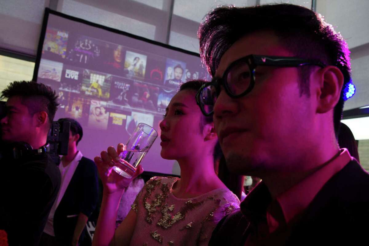 FILE - In this Aug. 26, 2014 file photo, Chinese celebrities attend the party for Sohu's online streaming website to share their passion for U.S. TV shows in Beijing, 10 days before the country's broadcast regulator says every foreign TV show and movie shown on Chinese online streaming sites will have to be approved by authorities by April or else go offline, in a tightening of control over the online industry. Now on Thursday, Oct. 9, China's state media reported Chinese authorities have ordered television stations, cinemas, online entertainment sites and other outlets not to show works by entertainers found to have been involved in vice crimes such as using drugs or visiting prostitutes. (AP Photo/Ng Han Guan, File)