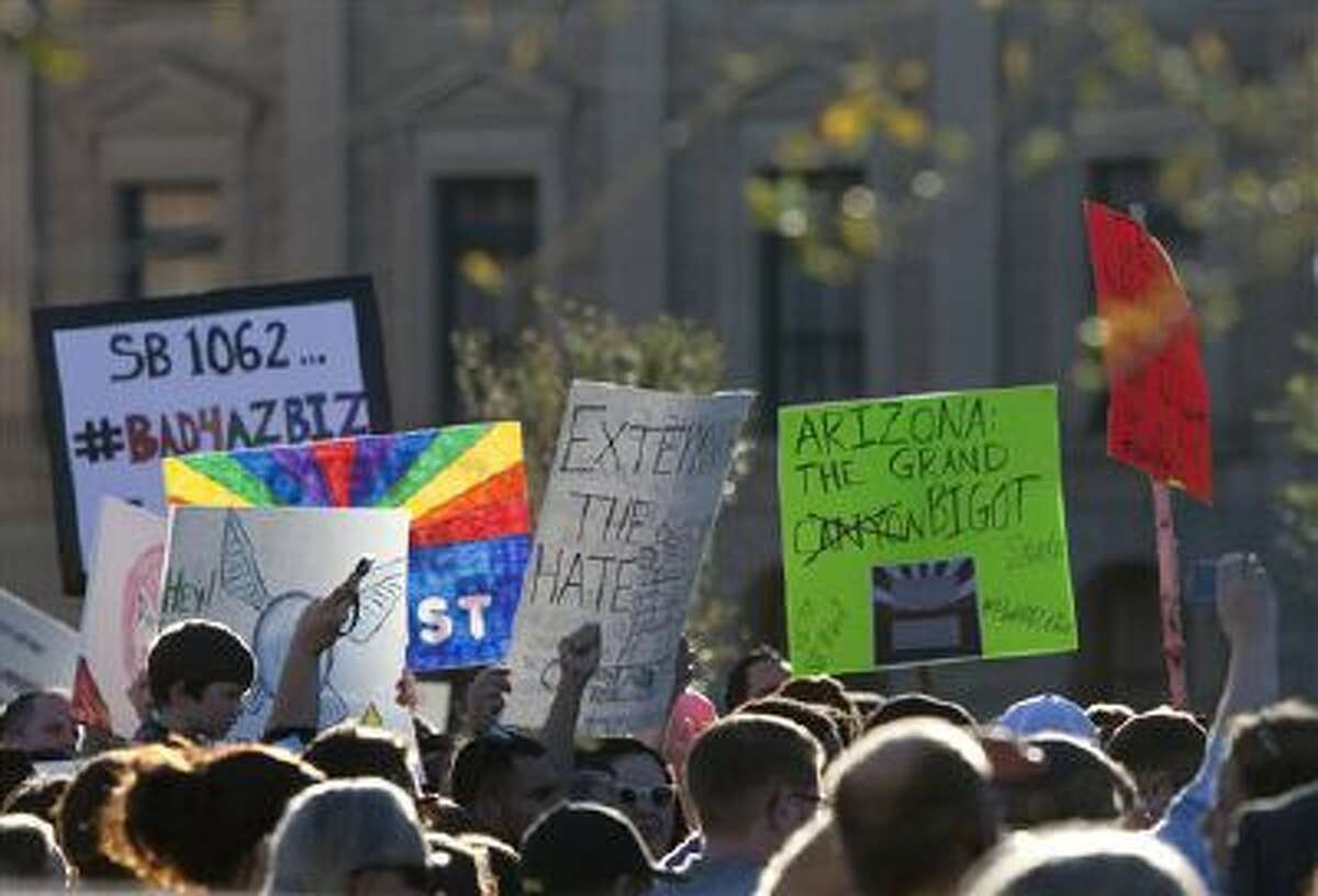 Opponents of the SB1062, a religious freedom bill, urged Gov. Brewer to veto the bill during a protest rally at the state Capitol, Friday, Feb. 21, 2014. (AP Photo/The Arizona Republic, Cheryl Evans)