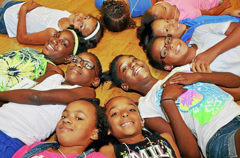 Local students participate in the first Green Street Girls in Science Summer Camp in 2014. Applications are now being accepted for the 2015 camp for girls, taught by Wesleyan science professors. Photo: File Photos