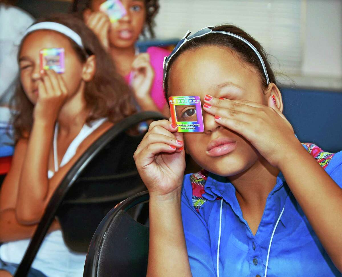 (Catherine Avalone/Middletown Press) Local students participate in the first Green Street Girls in Science Summer Camp in 2014. Applications are now being accepted for the 2015 camp for girls, taught by Wesleyan science professors.
