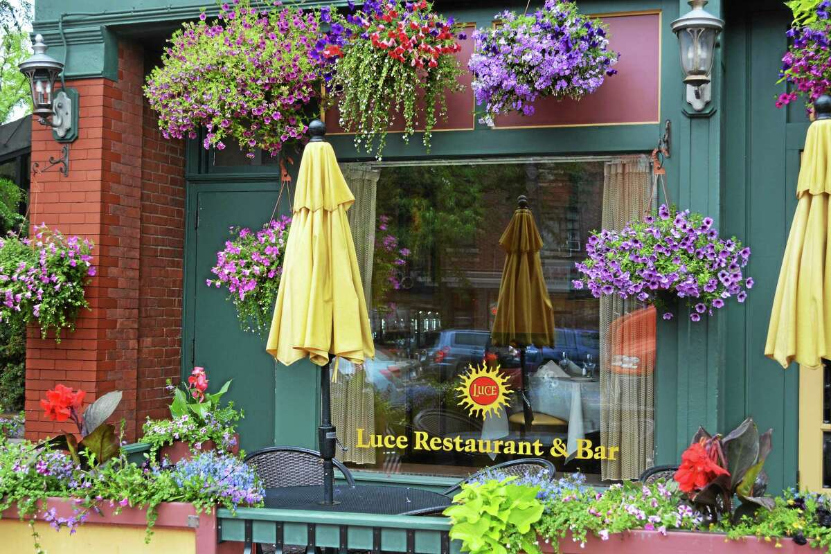 Flowers greet passersby and patrons of the Luce Restaurant & Bar on Main Street in Middletown. Some business owners have expressed concern that more police officers should be walking the streets after a recent spate of vandalism to their plants outside.