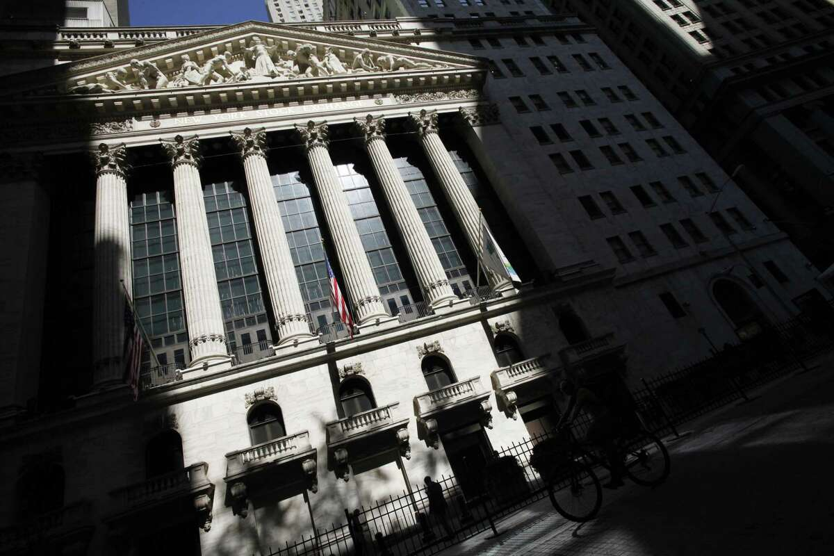 FILE - This July 15, 2013 file photo shows the New York Stock Exchange in New York. U.S. stocks are opening lower Monday, June 15, 2015, after weekend talks between Greece and its creditors stalled, raising the possibility the country could default.