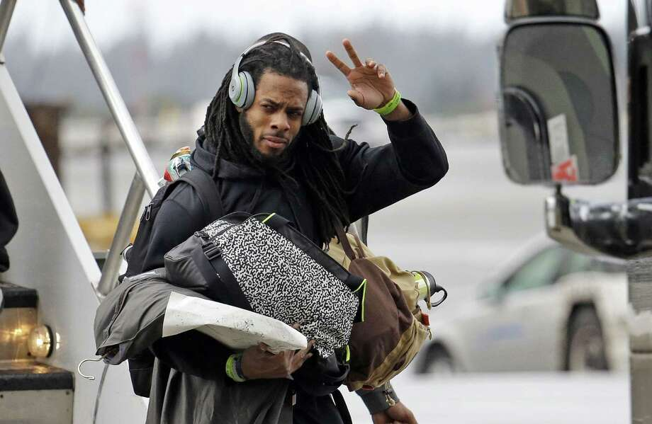 Seattle Seahawks cornerback Richard Sherman waves toward fans on the team's return from the Super Bowl on Feb. 2. Photo: Elaine Thompson — The Associated Press  / AP