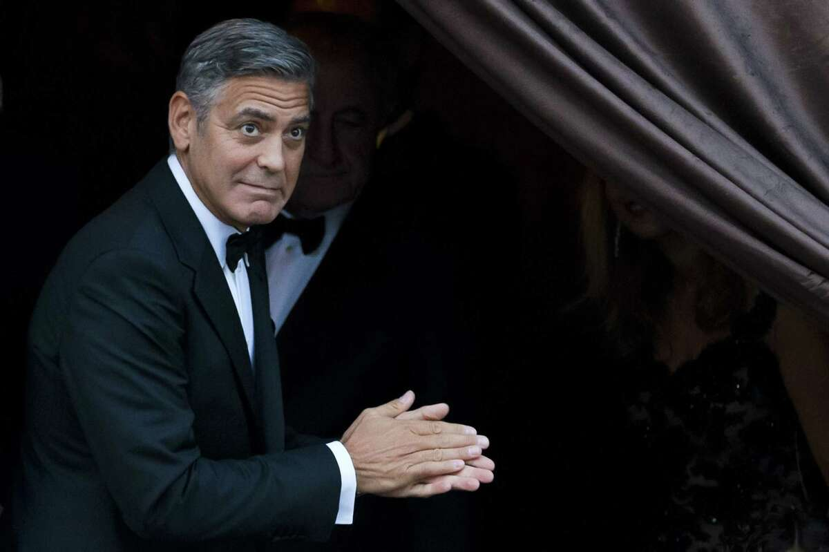 FILE - In this Sept. 27, 2014 file photo, George Clooney arrives at the Aman hotel in Venice, Italy. Clooney made an appearance at New York Comic Con, Thursday, Oct. 9, 2014 for a panel on his upcoming film,
