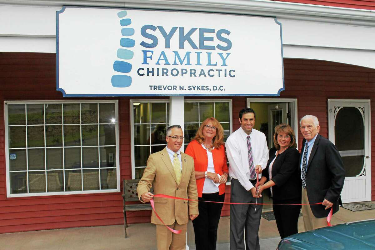 State Reps. Vin Candelora and Noreen Kokoruda, Trevor Sykes of Sykes Family Chiropractic, Durham First Selectwoman Laura Francis and Middlesex County Chamber of Commerce President Larry McHugh.