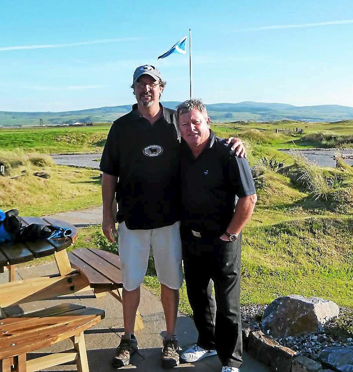 "Shown is author of ""To the Nines,"" Anthony Pioppi, in 2013 at Machrihanish Dunes in Scotland along with Ian Woosnam of Wales, who won the 1991 Masters and was ranked No. 1 in the world for 50 straight weeks in 1991-92, according to Pioppi. ""I forecaddied for his group, which also included David J. Russell, a European Senior Tour player."""