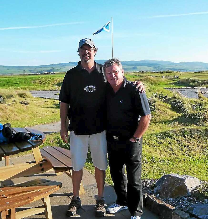 """Shown is author of """"To the Nines,"""" Anthony Pioppi, in 2013 at Machrihanish Dunes in Scotland along with Ian Woosnam of Wales, who won the 1991 Masters and was ranked No. 1 in the world for 50 straight weeks in 1991-92, according to Pioppi. """"I forecaddied for his group, which also included David J. Russell, a European Senior Tour player."""" Photo: Courtesy Of Colin Chrystie"""