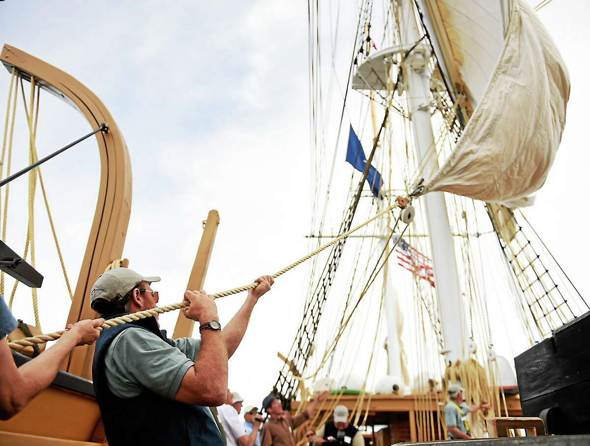 First mate Sam Sikkema helps set the main sail as the historic whaleship Charles W. Morgan tacks on the second of four sea trials day sails, its first time under sail since 1922 on June 8, 2014 out of New London, Conn.