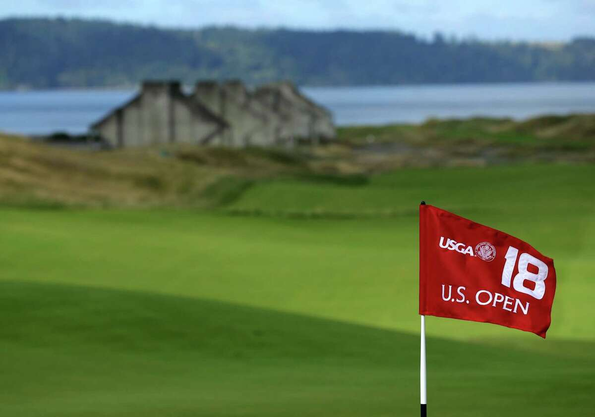 The U.S. Open 18th hole flag is shown at Chambers Bay, the host course for the 2015 U.S. Open golf tournamen, in University Place, Wash.