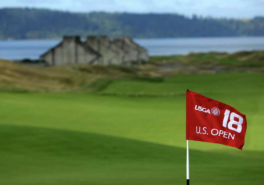The U.S. Open 18th hole flag is shown at Chambers Bay, the host course for the 2015 U.S. Open golf tournamen, in University Place, Wash. Photo: The Associated Press File Photo  / AP