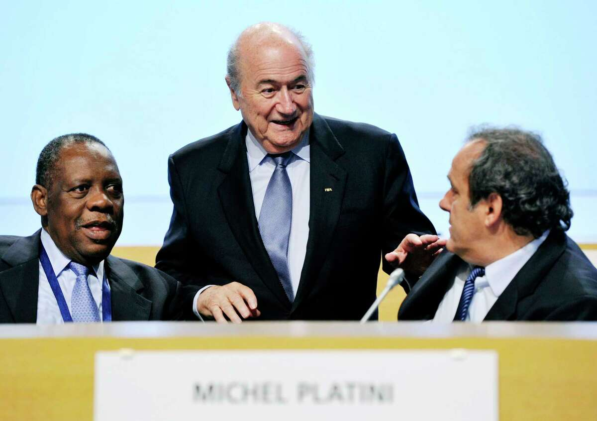 FIFA President Sepp Blatter, center, and UEFA President Michel Platini, right, have been banned for 90 days.