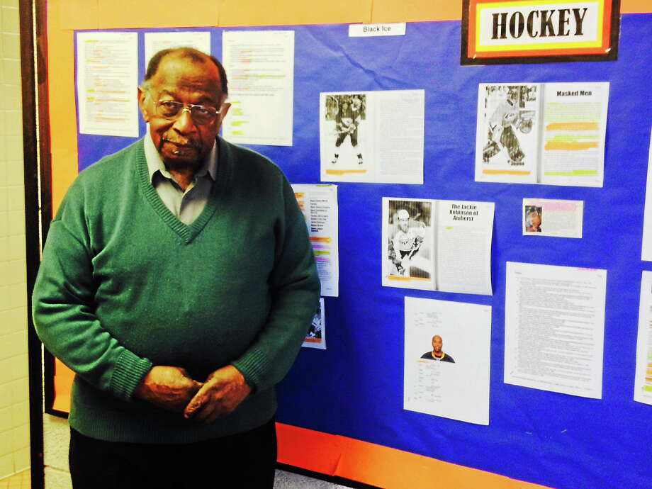 Michael T. Lyle Jr. - The Middletown Press  Longtime Middletown resident Ray Townes stands next to his collection of famous African-American figures that are currently on display at Keigwin Middle School. Photo: Journal Register Co.