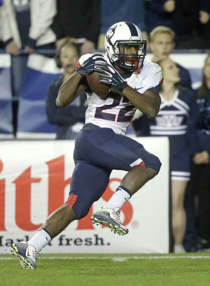 UConn running back Arkeel Newsome (22) scores against BYU during last Friday's game in Provo, Utah. Photo: Rick Bowmer — The Associated Press  / AP