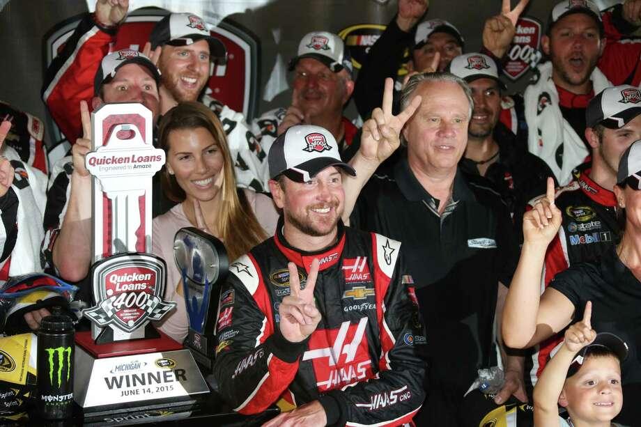 Kurt Busch celebrates in the winner's circle after winning at Michigan International Speedway on Sunday. Photo: Bob Brodbeck — The Associated Press  / FR3471 AP