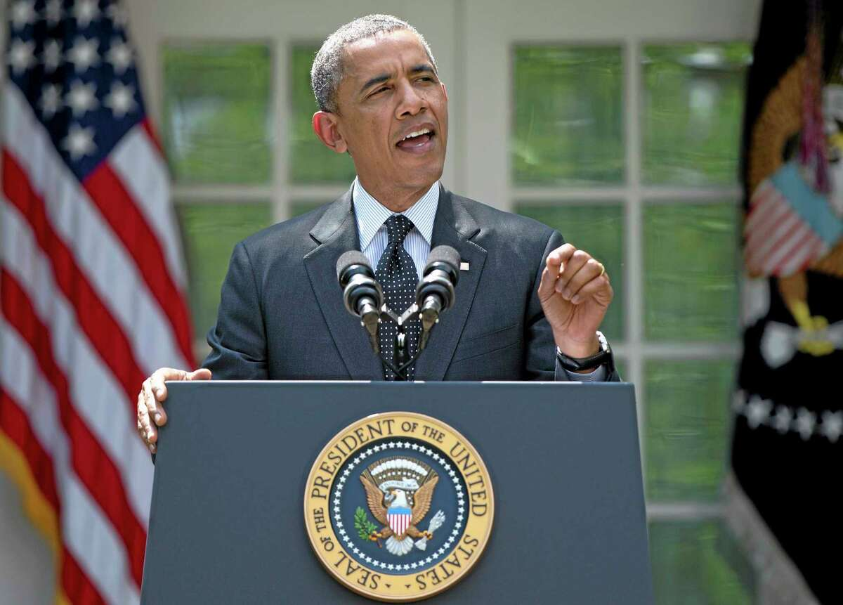 FILE - This May 27, 2014, file photo shows President Barack Obama, standing in the White House Rose Garden, and speaking about the future of US troops in Afghanistan. Obama outlined a timetable for the gradual withdrawal of the last U.S. troops in Afghanistan, and confidently declared,