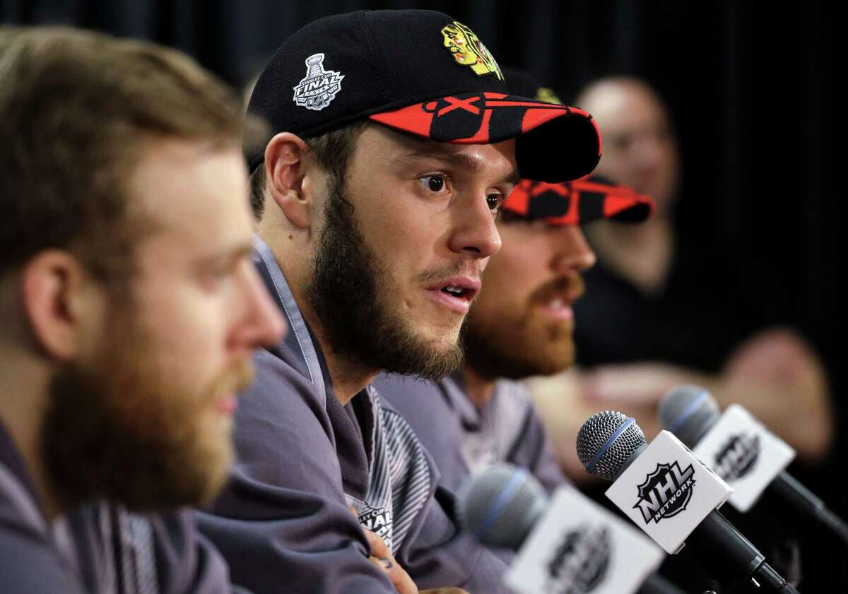 Blackhawks center Jonathan Toews talks during a news conference Sunday in Chicago.