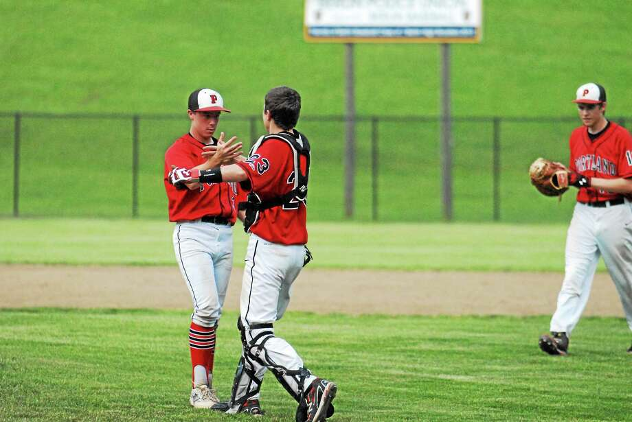 Jimmy Zanor - Middletown Press Portland freshman catcher Roland Thivierge congratulates pitcher Cole Ogorzalek after the final out in the Class S semifinals at Sage Park in Berlin. Photo: Journal Register Co.