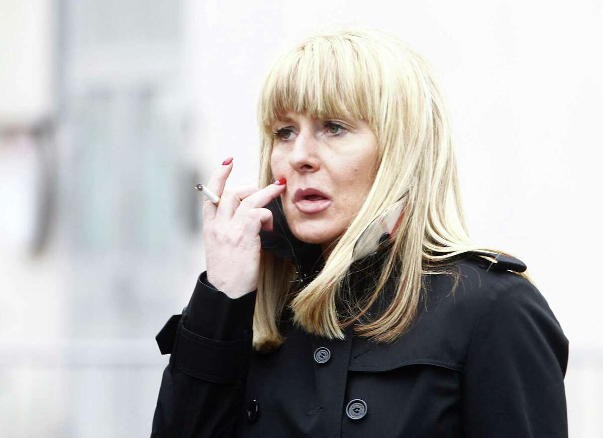 Beatrice Legrain leaves the Lille courthouse, northern France, Tuesday, Feb. 10, 2015. Dominique Strauss-Kahn goes on trial for sex charges in France. The former head of the International Monetary Fund, whose career went down in flames amid accusations of sexually assaulting a hotel maid in New York, is facing similarly shocking charges in France: aggravated pimping and involvement in a prostitution ring operating out of luxury hotels.(AP Photo/Michel Spingler)