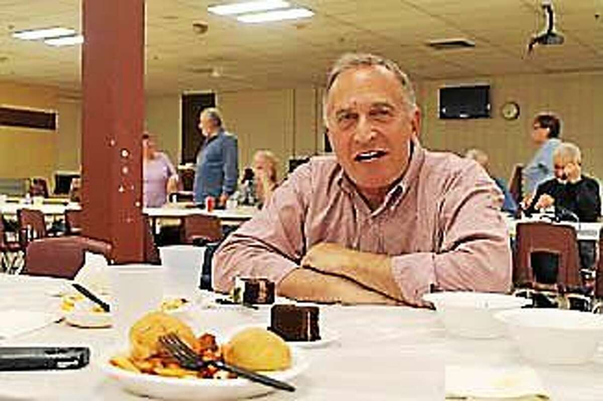 Mark Greenberg answers questions Friday during a pasta dinner fundraiser in Cheshire.