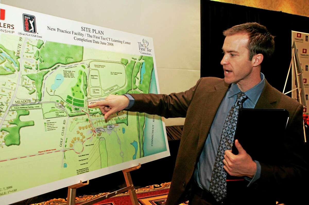 Travelers Championship tournament director Nathan Grube points out changes to be made to the TPC River Highlands facility at a news conference in Hartford on Dec. 7, 2006.