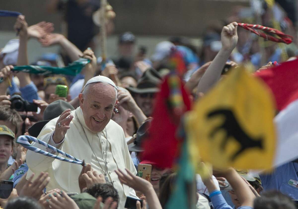 Pope Francis is cheered by the crowd as he arrives for an audience with Italian AGESCI boy scouts association's members in St. Peter's Square at the Vatican on June 13, 2015.