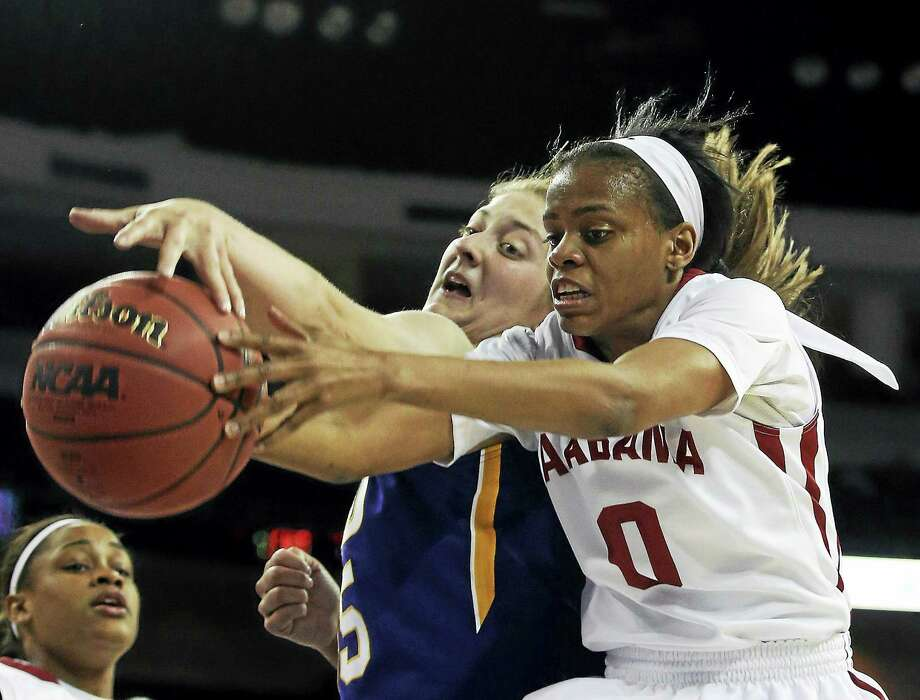 Alabama guard Daisha Simmons (0) and LSU forward Theresa Plaisance reach for the ball during a March 6 game in Duluth, Ga. Photo: Jason Getz — The Associated Press File Photo  / FRE6426 AP
