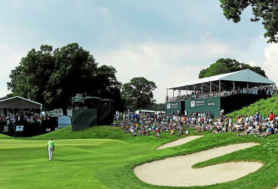 Davis Love III walks up the 15th fairway during the second round of the 2013 Travelers Championship at TPC River Highlands in Cromwell. Photo: Fred Beckham — The Associated Press File Photo  / FR153656 AP