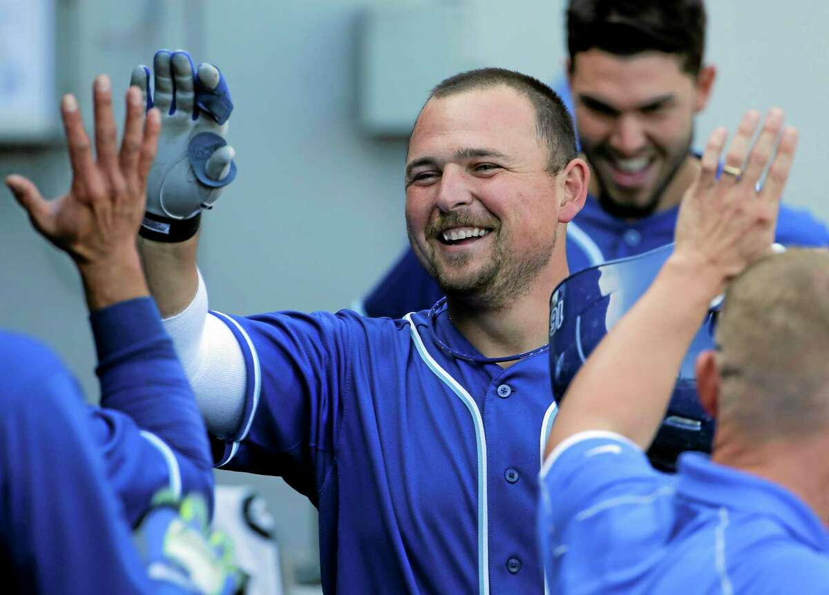 Kansas City Royals DH Billy Butler smiles in the dugout after hitting a two-run home run during the ninth inning of Saturday's 9-1 win over the White Sox in Chicago.