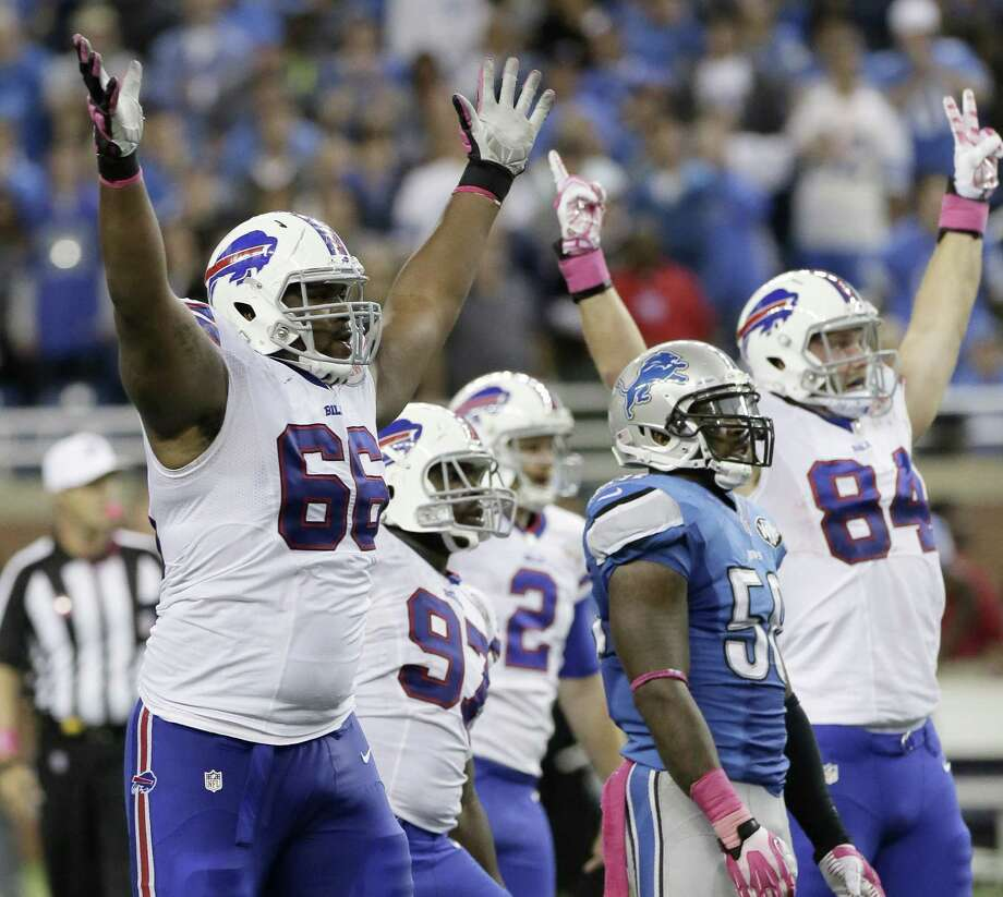 Buffalo Bills tackle Seantrel Henderson (66) celebrates as he watches a 58-yard game-winning field goal Sunday against the Lions in Detroit. Photo: Duane Burleson — The Associated Press  / FR38952 AP