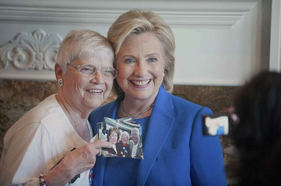 Anita Wendt, of Sioux City, Iowa poses for a photo with Democratic presidential hopeful, former Secretary of State Hillary Rodham Clinton, during a campaign house party on June 13, 2015, in Sioux City, Iowa. Photo: Justin Wan/The Sioux City Journal Via AP  / Sioux City Journal