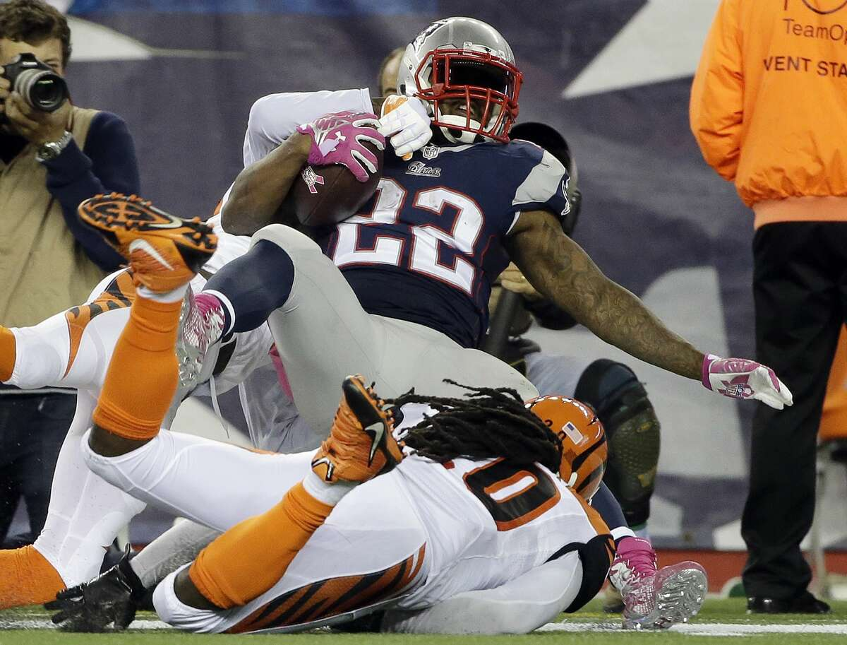 Cincinnati Bengals free safety Reggie Nelson (20) tackles New England Patriots running back Stevan Ridley (22) during Sunday's game in Foxborough, Mass.