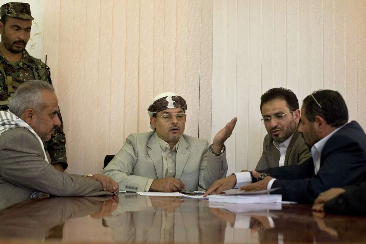 Yahya al-Houthi, center, brother of Houthi leader, Abdel-Malek al-Houthi attends a meeting at parliament in Sanaa, Yemen, Monday, Feb. 9, 2015. Yemen's Shiite rebels are meeting with political rivals for the first time since cementing their power grab last week by dissolving parliament and making their top security body the de facto government. (AP Photo/Hani Mohammed)