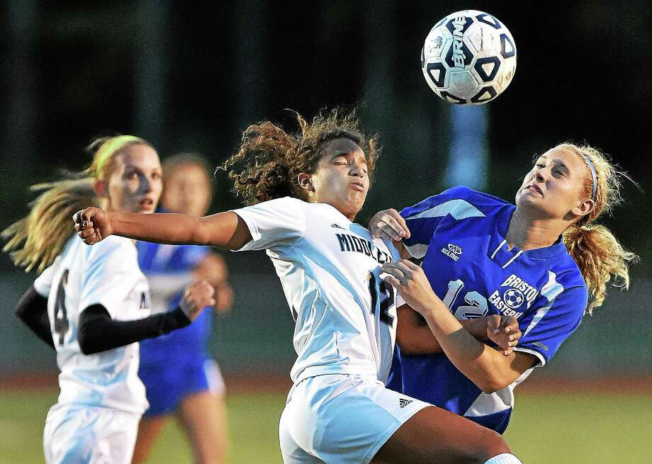 Middletown's Sam Fletcher and Bristol Eastern's defender Cierra Carillo jump up for a header on Monday. Fletcher had a hat trick on Wednesday against Plainville. Photo: Catherine Avalone — The Middletown Press  / New Haven RegisterThe Middletown Press