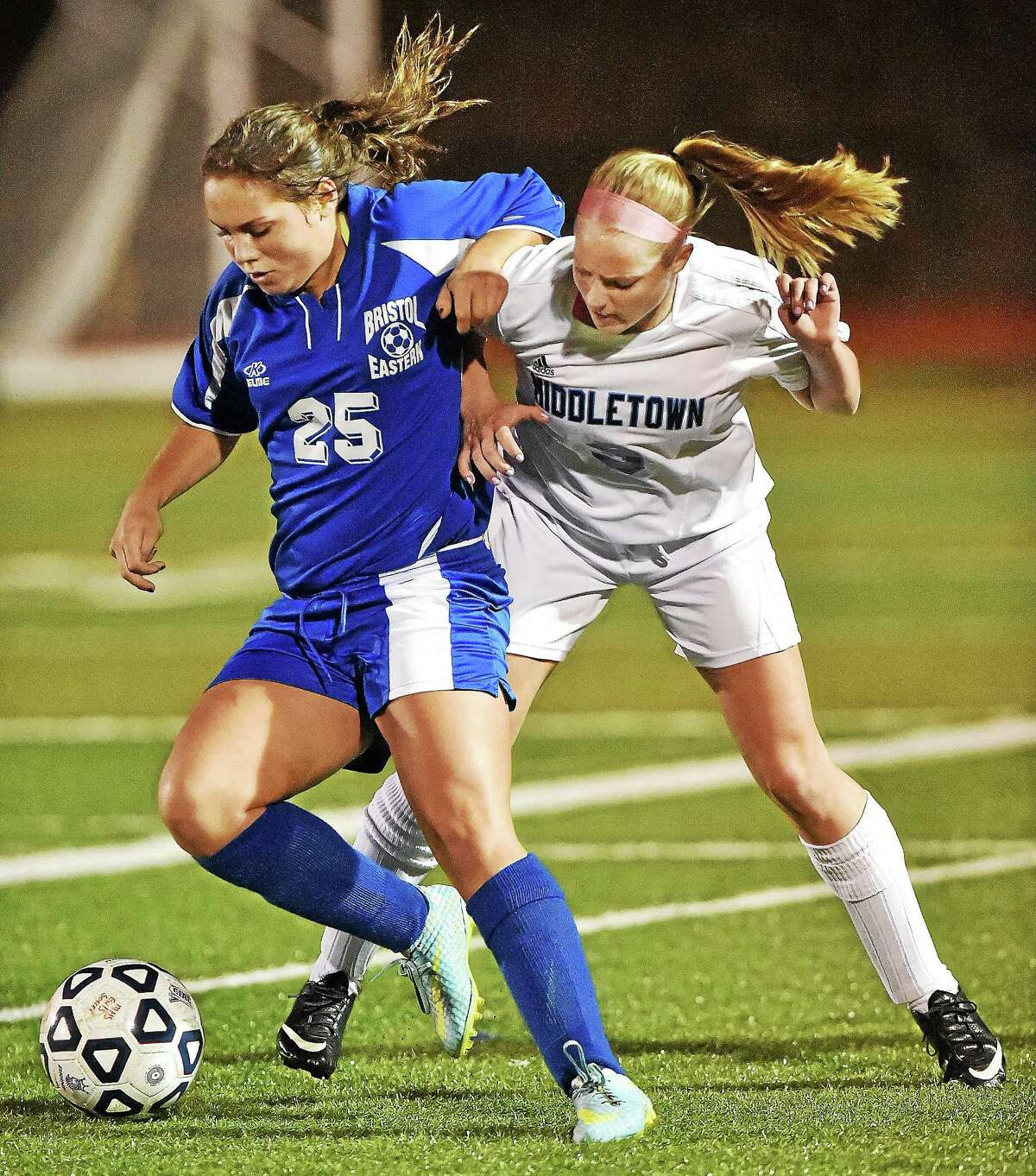 Middletown's Vanessa Bronson battles Bristol Eastern's Alyssa Dess on Monday.