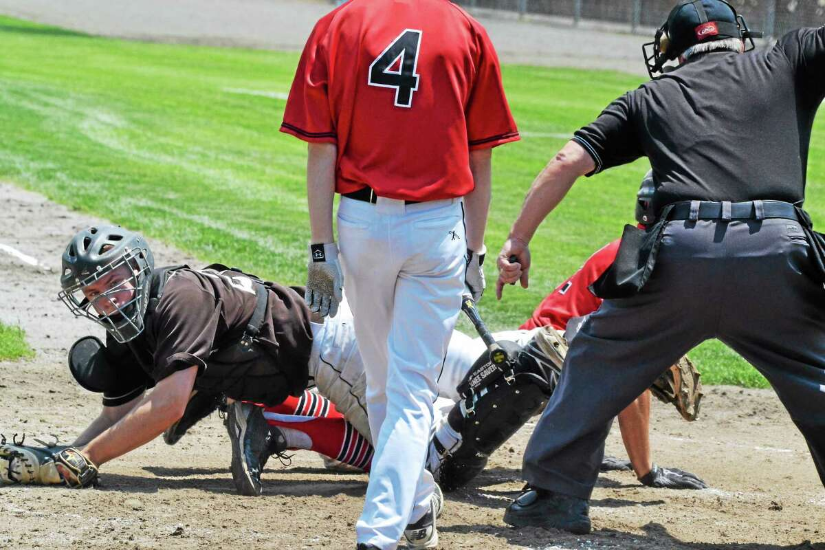 Thomaston's Tyler Donofrio looks up at the umpire after tagging out Portland's Josh Scovill who tried to steal home in the first inning.