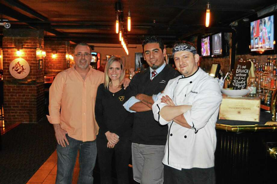 Julie Rancourt — Special to the Press  The team behind the recent changes to Celtic Cavern at Middletown's Main Street Market are, from left, Owner Scott Brown, head of marketing Jamie Tomassetti, Manager, Consultant and Executive Chef Jay Escudero and Chef Chris Sassi. Photo: Journal Register Co.